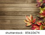 autumn leaves over wooden... | Shutterstock . vector #85610674