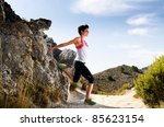 young woman stretching on a dry ... | Shutterstock . vector #85623154