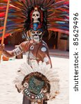TULUM, MEXICO - JULY 15: Unidentified man in Mayan traditional ornamental feather headdress dances to please the rain god Xipe Totec on July 15, 2011 in Tulum, Quintana Roo, Mexico - stock photo