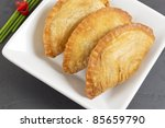 Curry Puffs (Epok-Epok / Karipap Pusing) - Deep Fried Malaysian, Singaporean, and Thai snack filled with curried meat and/or vegetables. - stock photo