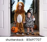 Trick or Treat; adorable children dressed up for Halloween - stock photo