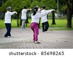 People Practising Tai Chi In...