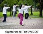 people practising tai chi in...   Shutterstock . vector #85698265