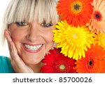 beauty portrait of young woman with flowers next to her face - stock photo