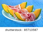 ham and melon on blue background | Shutterstock . vector #85713587