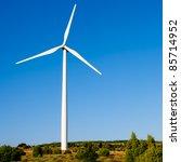 Small photo of aerogenerator windmill in sunny blue sky day