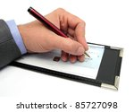 Small photo of closeup of a hand writing a check