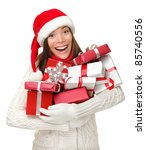 Santa hat Christmas woman holding christmas gifts smiling happy and excited. Cute beautiful multi-racial Caucasian Asian santa girl isolated on white background. - stock photo