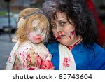 LIMERICK, IRELAND - OCTOBER 1:  Portrait of unidentified woman with child in zombie costumes on the street of Outbreak Limerick Zombie Festival on October 1st, 2011 in Limerick, Ireland - stock photo