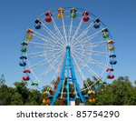 A colourful ferris wheel. front ...