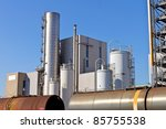 refinery with train wagons for liquid transport - stock photo