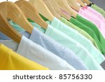 Stock photo line of multi colored shirts on wooden hangers 85756330
