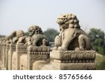 the stone lion on the lugouqiao bridge in beijing,China - stock photo