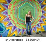 Pre Teen Girl In Front Of Mural
