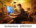 young man at home using a... | Shutterstock . vector #85837603