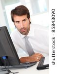 businessman sitting at his desk ... | Shutterstock . vector #85843090