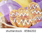 Easter sugar cookies in a decorative ceramic dish with pastel colored tissue paper.  Close-up with shallow dof - stock photo