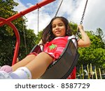 Swinging [Approx. 4 years old] - stock photo