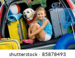 Travel, tourism - Girl with dog ready for the travel for summer vacation - stock photo