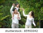 happy asian family enjoying... | Shutterstock . vector #85903342