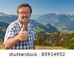 senior man on top of a mountain ... | Shutterstock . vector #85914952