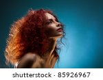 Beauty Portrait Of A Curly Red...
