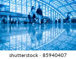 passenger walking with motion blur in the beijing capital airport - stock photo