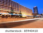 light trails on the modern city street at dusk in beijing,China - stock photo