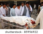 Small photo of QUETTA, PAKISTAN -OCT 04: People weep over dead body of a firing victim who was gunned down in terrorists attack at Bolan medical complex hospital (BMC) on October 04, 2011in Quetta, Pakistan