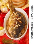 whole carp baked with flaked almonds served on sauerkraut (bigos) for  christmas - stock photo