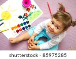 Little Cute Girl Painting Sun...