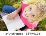portrait of happy girl with book | Shutterstock . vector #85994116