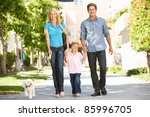 Stock photo family walking with dog in city street 85996705