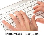 Man Typing On A Keyboard On...