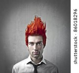 Young Businessman With Flaming...