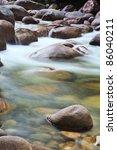Pebbles Or Rocks In Creek Or...