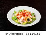 Salad with shrimps, caviar, calamaries, lettuce, lemon and olive - stock photo