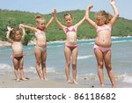 children on the beach with sun lotion - stock photo