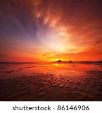 Sunset Over Sandy Beach In Low...
