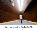 Woman thinking about modern architecture - stock photo