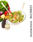 Vegetable salad in a bowl on white surface - stock photo
