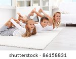 Family doing gymnastic exercises at home - healthy life education - stock photo