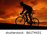 Small photo of silhouette of the cyclist riding a road bike at sunset