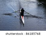 A Single Rower Practices His...