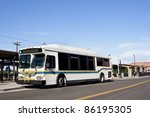 a city bus stops in a downtown... | Shutterstock . vector #86195305