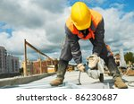 builder worker with grinder...
