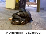 Homeless Man Sleeps On Pavemen...