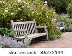 Stock photo rose garden in the park with empty wooden bench hyde park london 86272144
