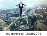 business man balancing on the... | Shutterstock . vector #86282776