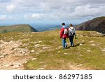 Two Hikers Walking On Snowdoni...